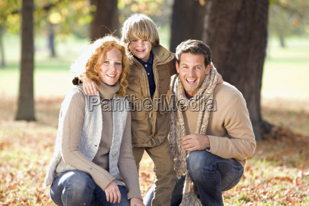 portrait of family in autumn forest