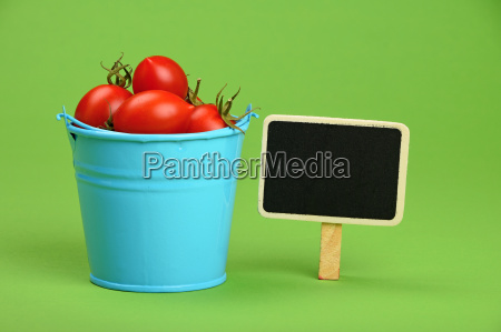 blue bucket of cherry tomatoes with