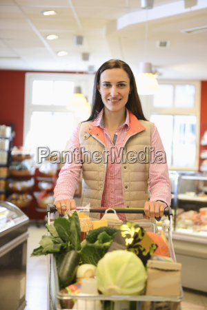 woman shopping in an organic grocery
