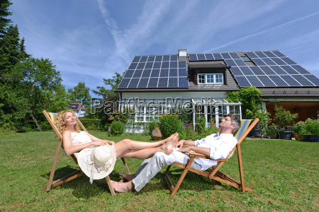 mid adult couple in deckchairs in