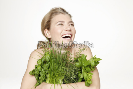 laughing young woman in studio holding