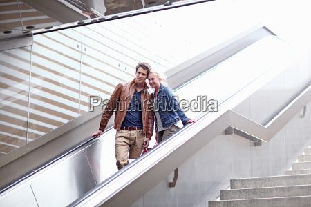 mid adult couple on escalator munich