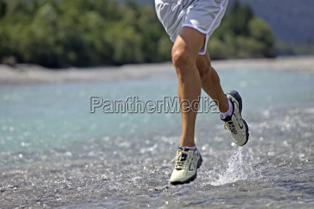 close up man running on water
