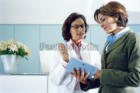 view of two young businesswomen looking
