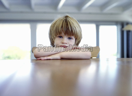view of young boy posing for
