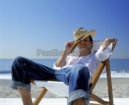 view of a man sitting in