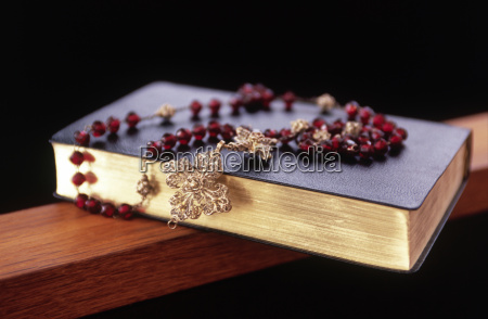 rosary beads on top of a
