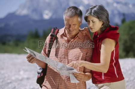 couple looking at map in hills