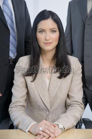 businesswoman sitting at desk with co