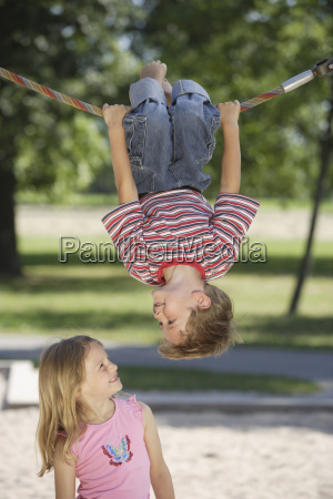 young brother and sister playing at