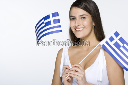 young woman holding greek flags