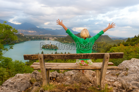 woman enjoying panoramic view of lake