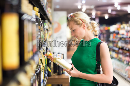 woman shopping groceries at supermarket
