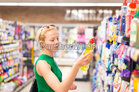 woman shopping cleaners at supermarket