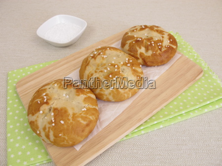 homemade lye bread rolls sprinkled with