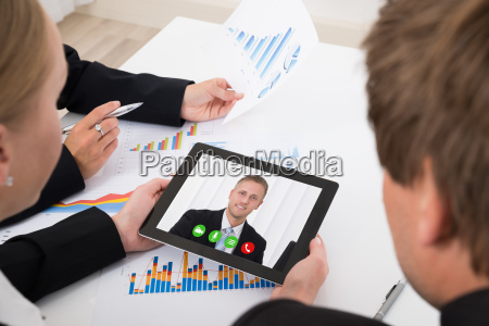 businesspeople video conferencing on digital tablet