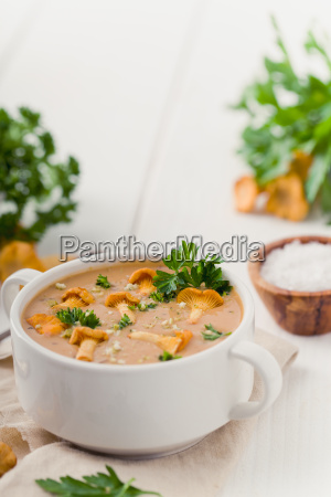 soup with chanterelles and parsley on