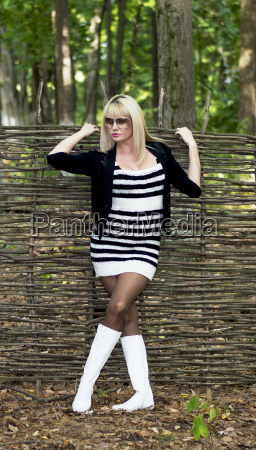 the blonde with white boots at