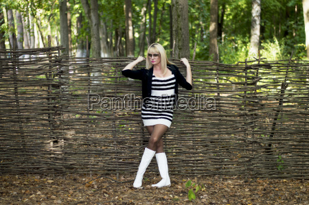 the beautiful blonde at a fence