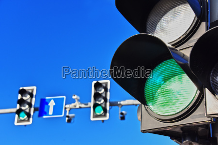 traffic lights over blue sky