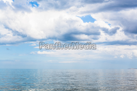 waterscape with white clouds and calm