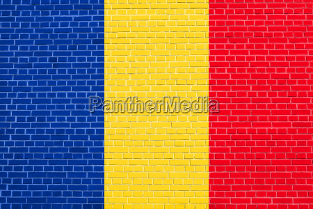 flag of romania on brick wall