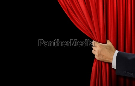 hand open stage red curtain on