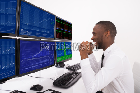 happy stock market broker looking at