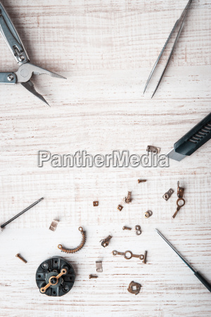 tools and disassembled mechanism on the