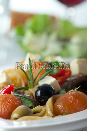 close up of pasta with tomatoes