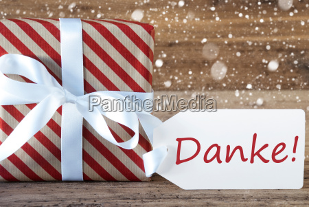 present with snowflakes text danke means