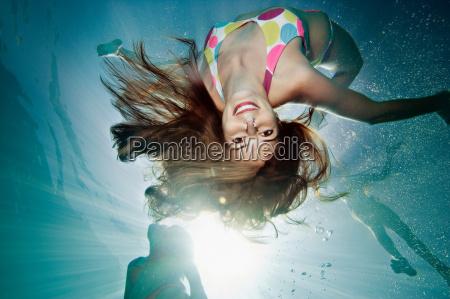 underwater portrait of female swimmer