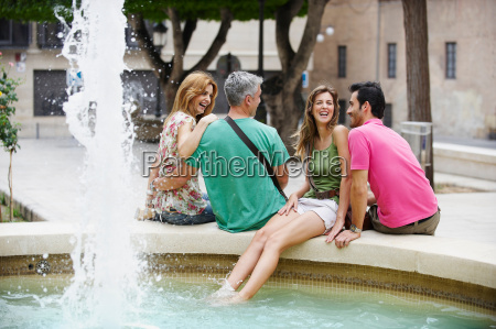 two tourist couples by fountain