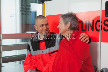 ambulance man caring about woman