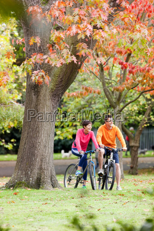 man and woman cycling in the