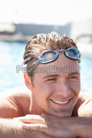 man wearing goggles in swimming pool