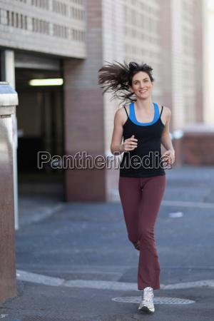 woman running on city street
