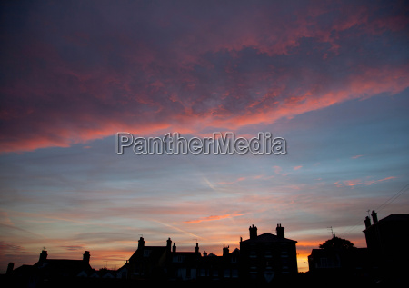 silhouette of houses at sunset