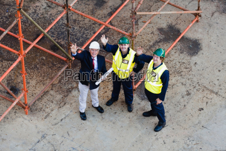 workers waving from dry dock