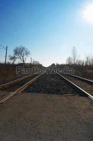 train tracks in rural landscape