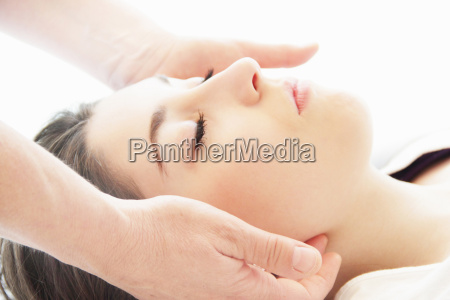 woman having facial massage in spa