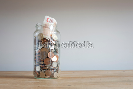 savings jar on desk