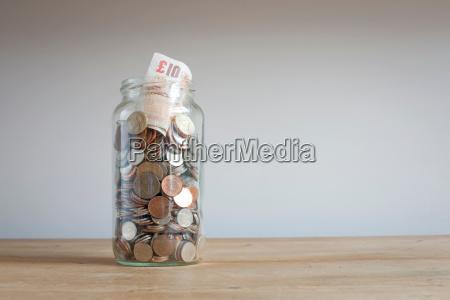 savings, jar, on, desk - 18166442