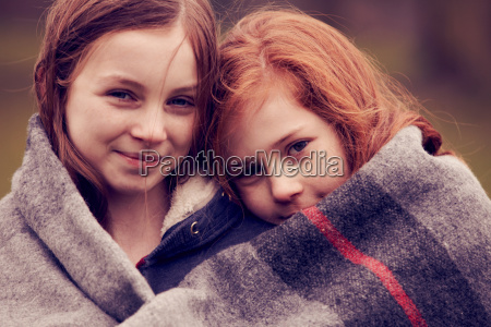 portrait of girls wrapped in a