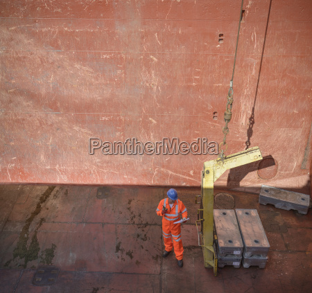 high angle view of worker checking