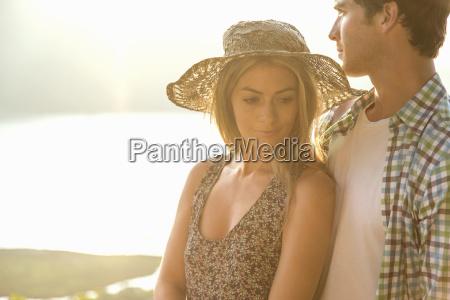 young couple woman wearing sunhat