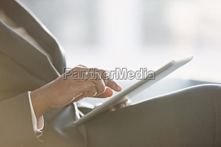 businesswoman using digital tablet close up