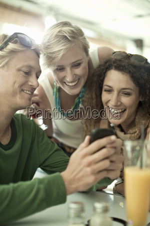 young adult friends looking at cellphone
