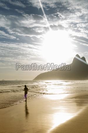 silhouette of woman on ipanema beach