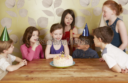 children at birthday party girl with